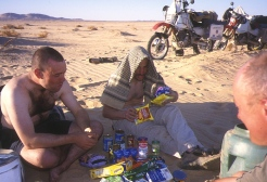 Tucking in after digging up the food and fuel cache at Erg Killian after a brilliant ride down in a day.